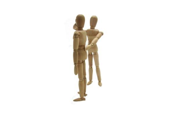 wooden figures illustrating firm posture